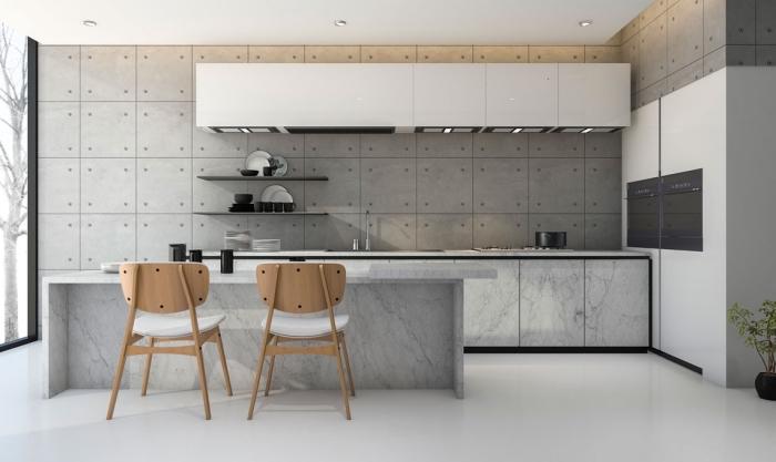 design contemporain esprit industriel dans une cuisine grise avec parquet blanc et armoires sans poignées, rangement mural étagère gris anthracite
