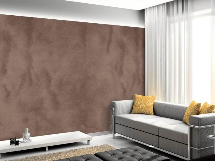 ambiance relaxante dans un salon gris avec mur à texture sable, idée peinture tendance sablée de nuance terreuse