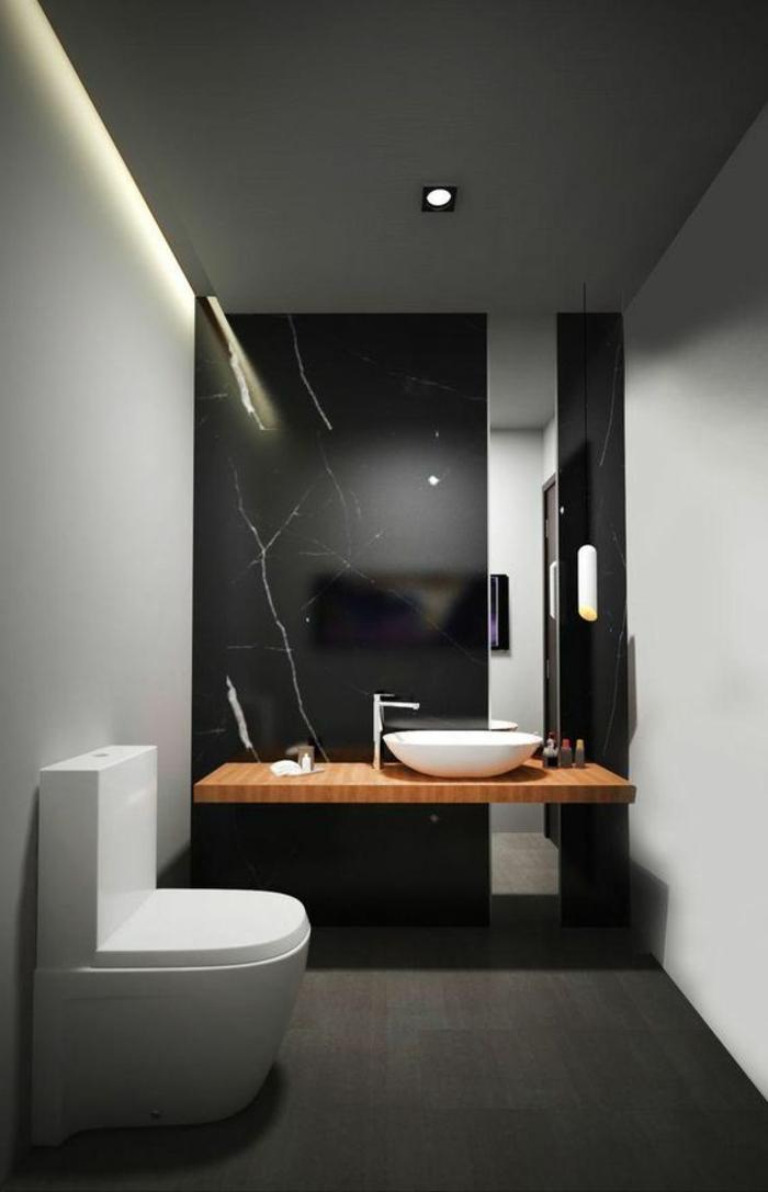 peinture murale gris clair, comptoir de bois et vasque à poser blanche, mur noir, spot encastré