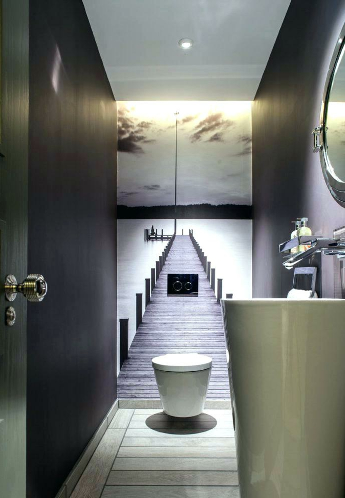 idee deco toilette en gris et blanc, poster mural trompe l'oeil, vasque colonne, miroir rond, peinture toilette noire
