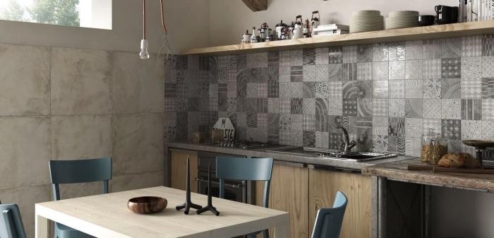 des carreaux de ciment patchwork en nuances de gris qui apportent de l'élégance à la cuisine en bois clair