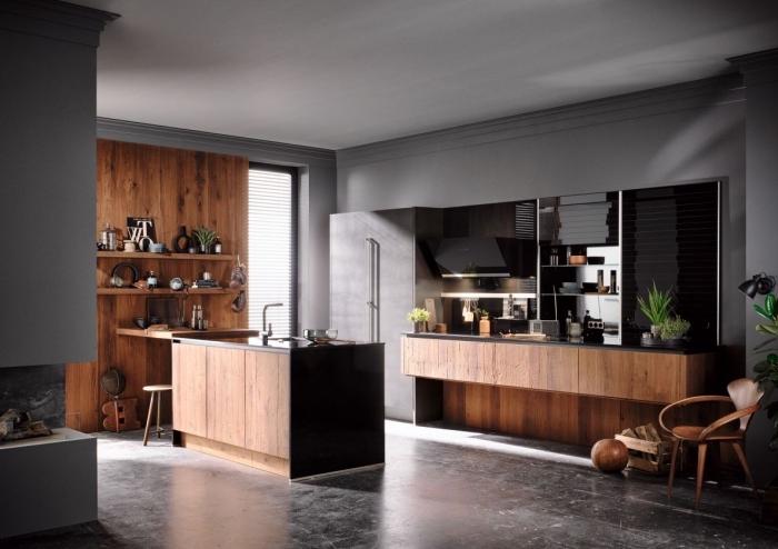cuisine bois moderne aux murs gris et plancher en carreaux effet béton, plan de travail cuisine en noir, façade cuisine en bois foncé