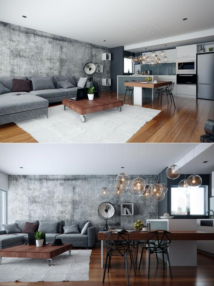 studio gris et blanc, lampes suspendues, îlot blanc, rallonge en bois, table basse sur roues, mur en béton