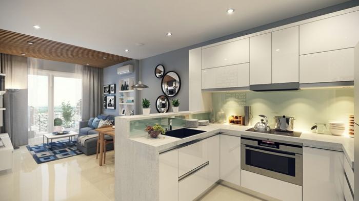 studio avec cuisine, murs bleus, sol en carreaux beiges, cuisie en L, amenager petite cuisine élégante