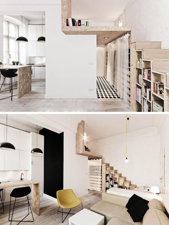 aménagement studio avec escalier bois avec rangement sous escalier, deco cuisine noir et blanc avec suspensions noires au dessus dun ilot central table bois, canapé beige