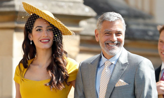 photo de george clooney au mariage royal de Harry et Meghan Markle pendant lequel Idris Elba a été choisi comme DJ