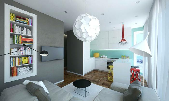 studio etudiant, étagère murale blanche, sofa gris, plafonnier blanc en papier, cuisine en L, grande lampe blanche, kitchenette pour studio , meuble kitchenette blanc, tabourets en couleurs vives