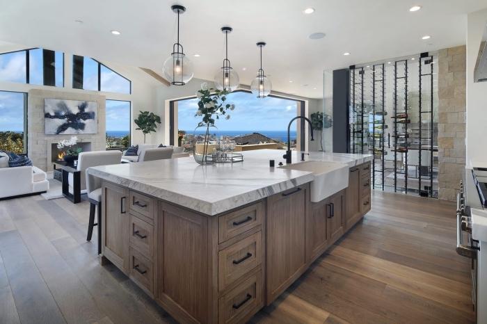 comment décorer une cuisine bois moderne ouverte avec îlot bimatière en bois et marbre, exemple de cuisine moderne bois