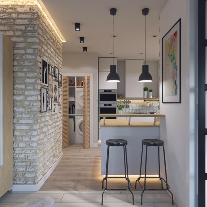 lampes noires suspendues, mur en briques blanches, amenagement petite cuisine blanche, coin cuisine avec fours à encastrer, carreaux métro