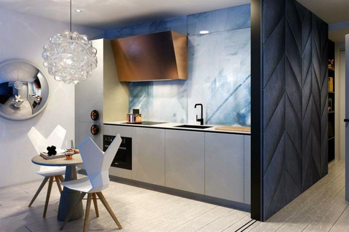 lampe suspendue en cristal, petite table ronde avec deux chaises design scandinave, petit studio etudiant