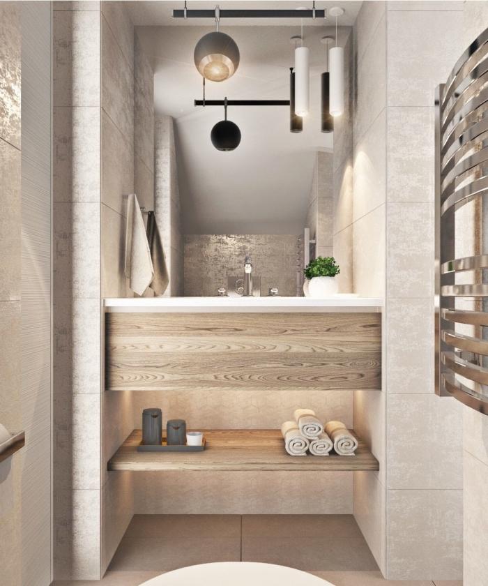 modèle de faience salle de bain moderne à effet pierre, déco petite salle de bain en beige et bois clair avec accents noirs