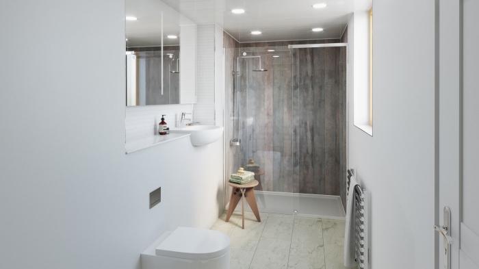 agencement petite salle de bain aux murs en peinture blanche avec cabine de douche aux panneaux effet bois