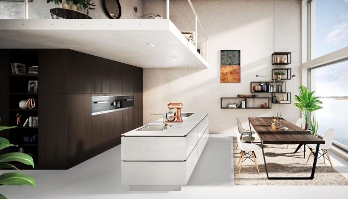 décoration cuisine moderne aux murs blancs avec meubles de rangement fermé en bois marron foncé, agencement cuisine avec îlot central