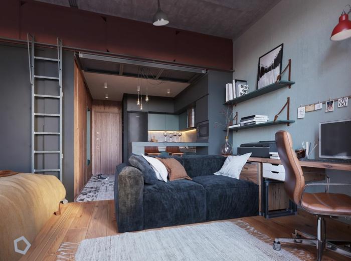 appartement gris et bois, bureau suspendu et chaise pivotante, grand sofa gris anthracite, petite cuisine avec îlot
