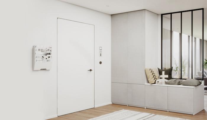 Exemple utilisation pose d'une verrière atelier avec vitres et cadre en aluminium noir pour séparation entrée et salon