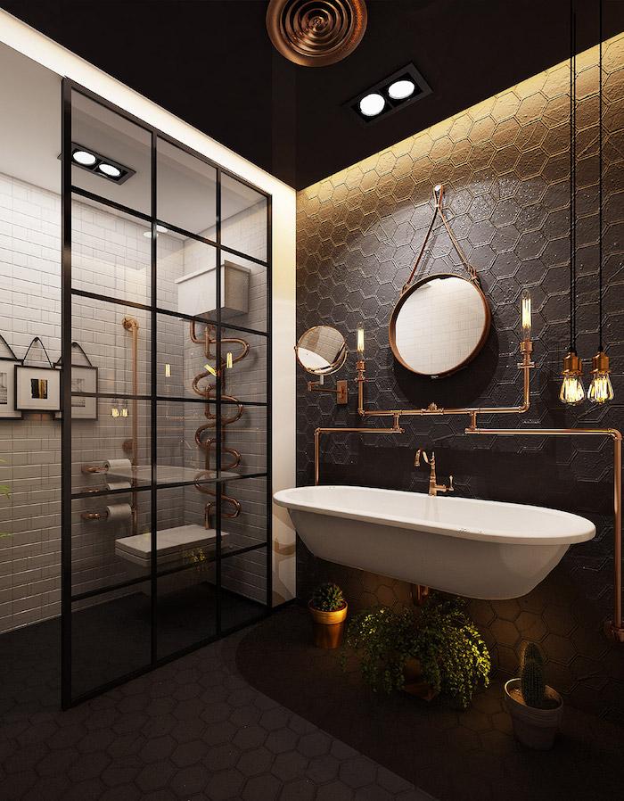 Style industriel dans la salle de bain, miroir ronde, intéressante lavabo qui peut etre utilisé comme baignoire, espace toilete