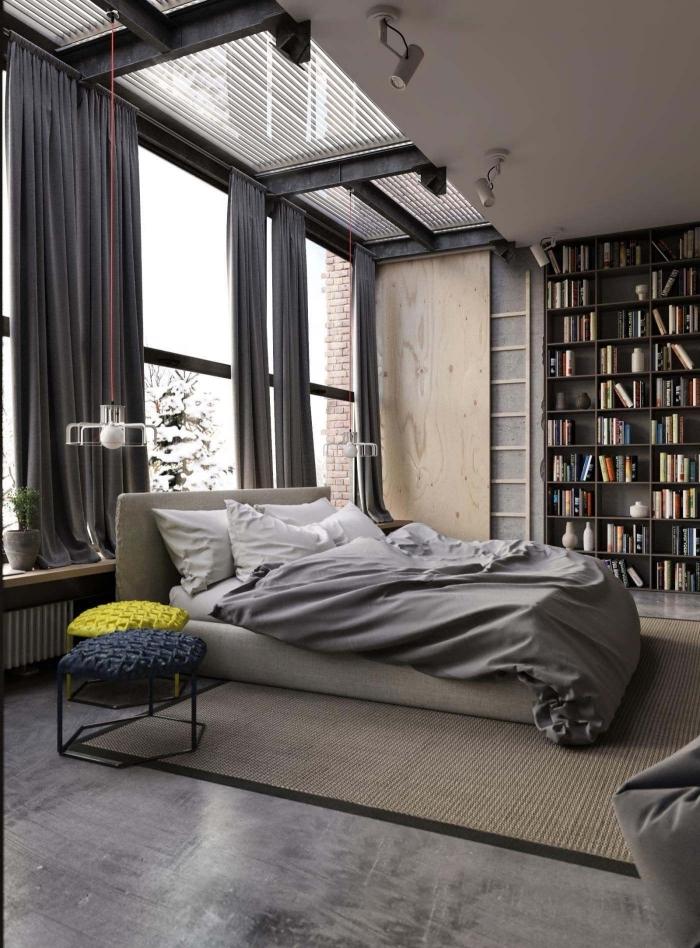 deco industrielle dans une chambre à coucher moderne à plancher béton, meuble rangement en bois, lampe suspendue à filament