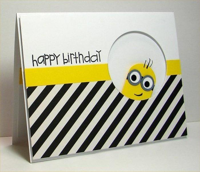 carte anniversaire enfant sur le thème minions en papier blanc, noir et jaune, carte de voeux minions à faire soi même