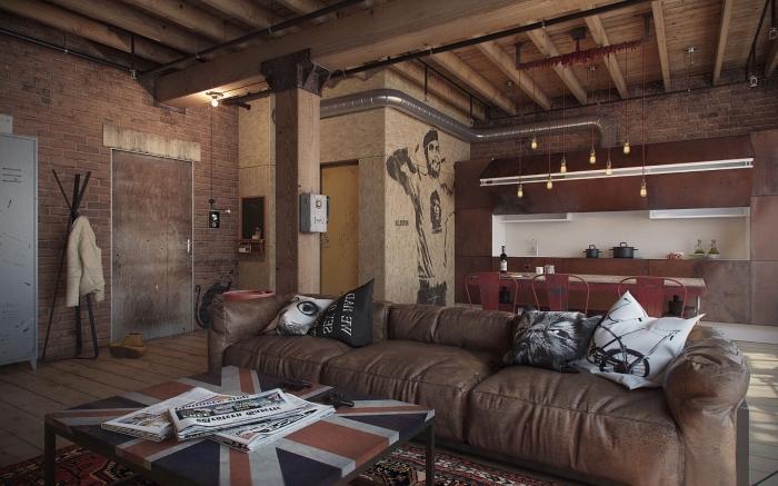 idée deco murale industrielle dans un loft, design intérieur industriel avec tuyaux et poutres apparents, idée canapé en cuir marron