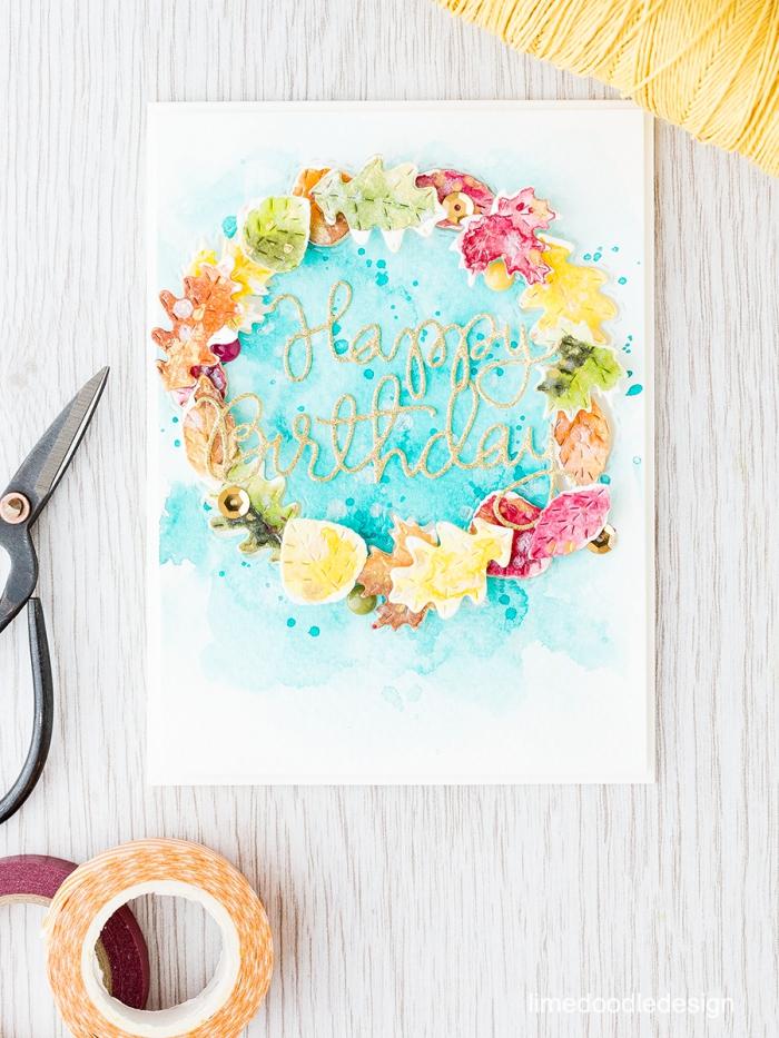 carte d'anniversaire fille motif aquarelle couleur turquoise décorée d'une couronne de feuilles en papier