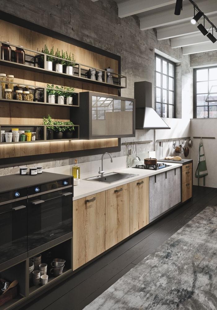 exemple de cuisine style industriel aux murs gris avec plafond poutres apparentes en blanc, rangement mural avec étagères bois et gris