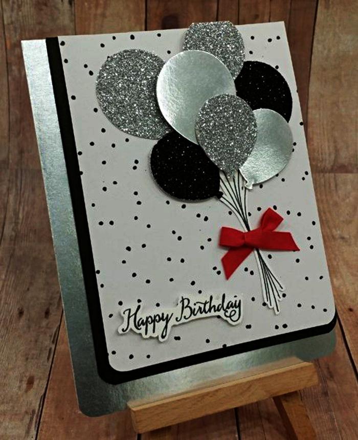 jolie carte d'anniversaire en blanc et noir sur un support de papier métallisé décorée de ballons en reliefs en papier argent et pailleté