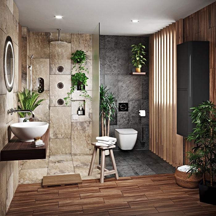 salle de bain de luxe en pierre naturelle avec douche italienne en carrelage gris en harmonie avec l'ambiance reposante et zen