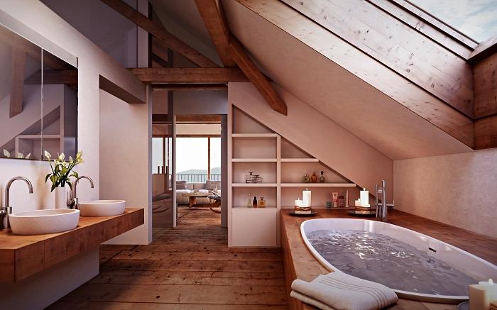 deco salle de bain zen aménagée sous pente avec baignoire au bord en bois et plan vasque en bois, étagère sous pente aménagée sous les combles