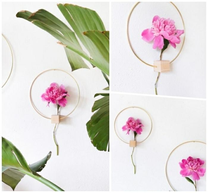 déco mur florale, cubes en bois percés et enfilés à un cerceau, grandes feuilles vertes