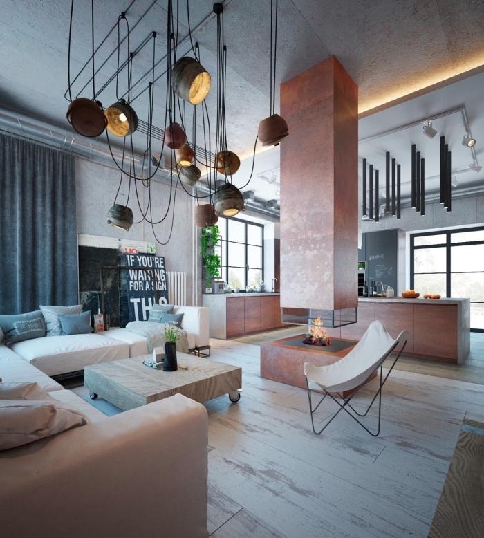 déco industrielle salon contemporain, loft moderne avec plancher bois et plafond béton aux murs gris clair, plantes vertes d'intérieur