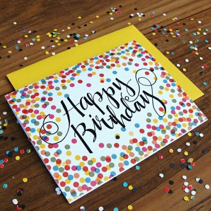 une simple carte d'anniversaire a faire soi meme décorée de confettis multicolores et d'un lettrage manuscrit noir