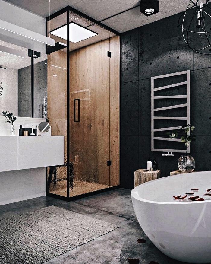 l'espace douche en bois délimité par un paroi vitré minimaliste dans une salle de bain moderne en blanc et noir