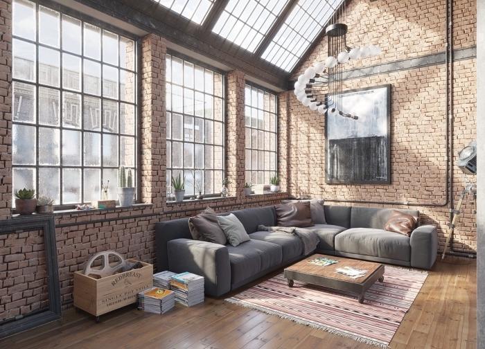 comment décorer un espace loft industriel, idée meuble style industriel dans un salon loft, modèle table basse en bois et métal