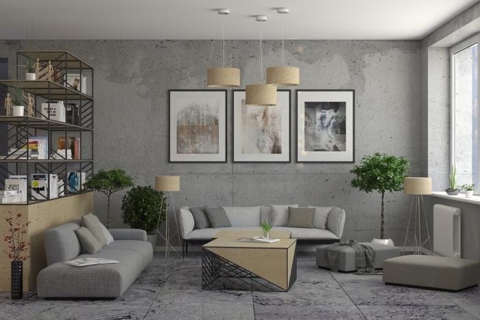 meuble rangement ouvert en métal, décoration salon industriel avec canapés en gris et table basse, mur de cadres noirs