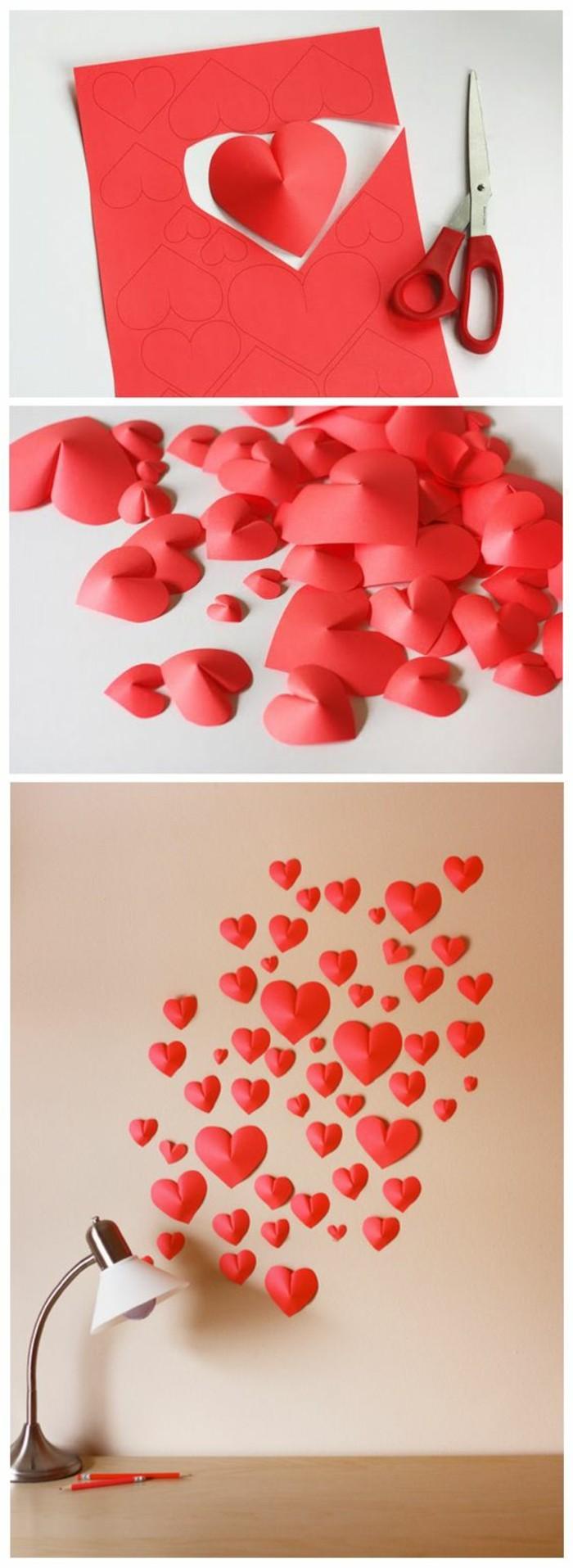 coeurs en papier, figures découpées en papier rouge, ciseaux, déco coeurs dispersés collés au mur