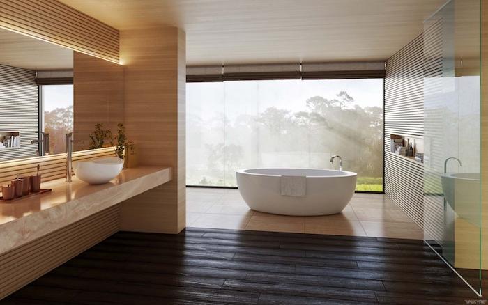 Vaste salle de bains avec baignoire et belle vue de la forêt, design salle de bain gris et blanc, beaux accessoires salle de bains