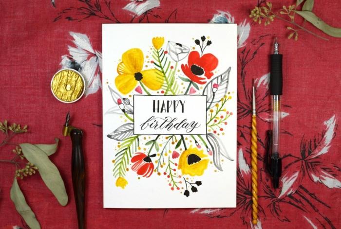 jolie carte anniversaire femme à motifs floraux à l'aquarelle et un lettrage manuscrit noir réalisé au feutre noir à pointe fine