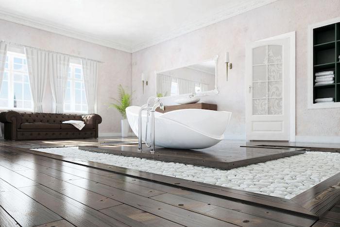 Magnifique salle de bain blanche avec détails brunes et pierres sur le sol pour déco zen, salle de bain zen calme et bien rangée