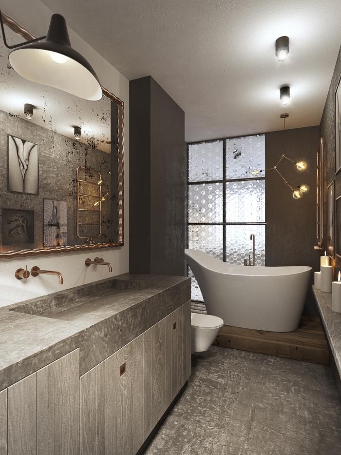 comment aménager une salle de bain moderne aux murs gris avec plancher effet béton, exemple évier béton avec robinet cuivre