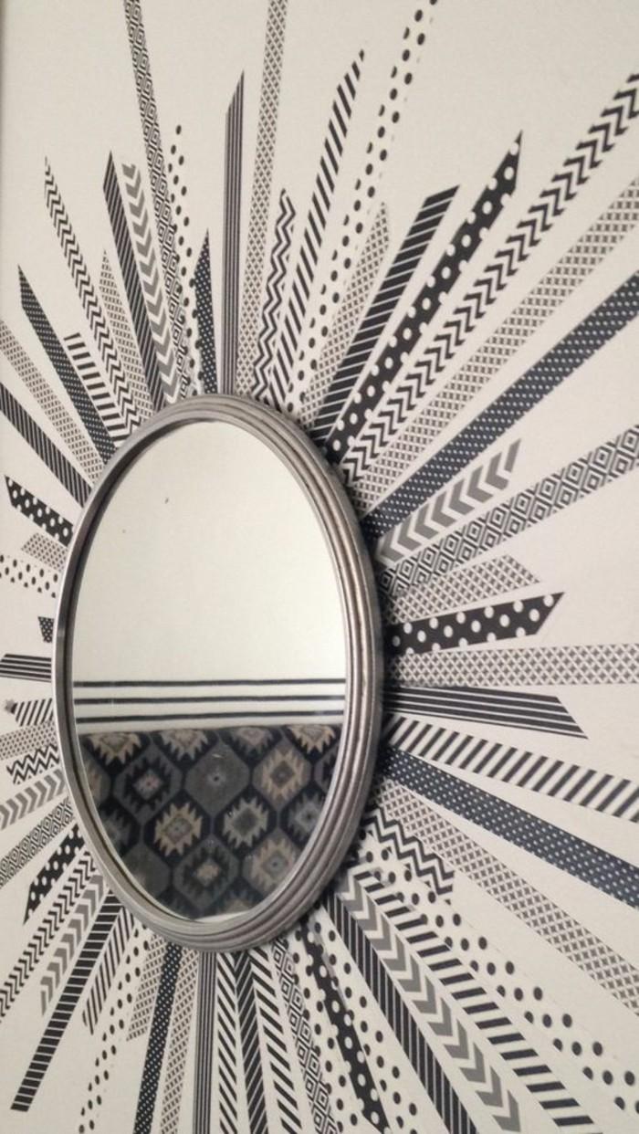 miroir décoratif à l'encadrement dessiné au mur, miroir soleil diy, idée deco salon