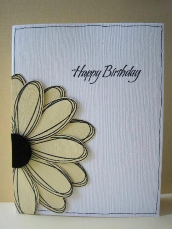carte d'anniversaire en papier texturé blanc décorée d'une fleur en 3d, à l'écriture manuscrite joyeux anniversaire