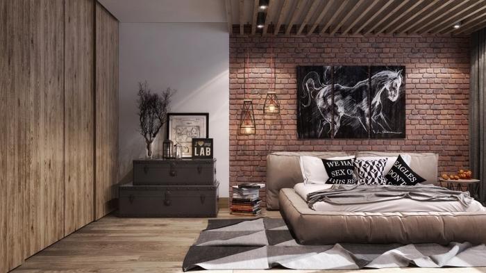 idée deco industrielle dans une chambre moderne avec mur en briques, modèle de garde robe avec portes coulissantes en bois
