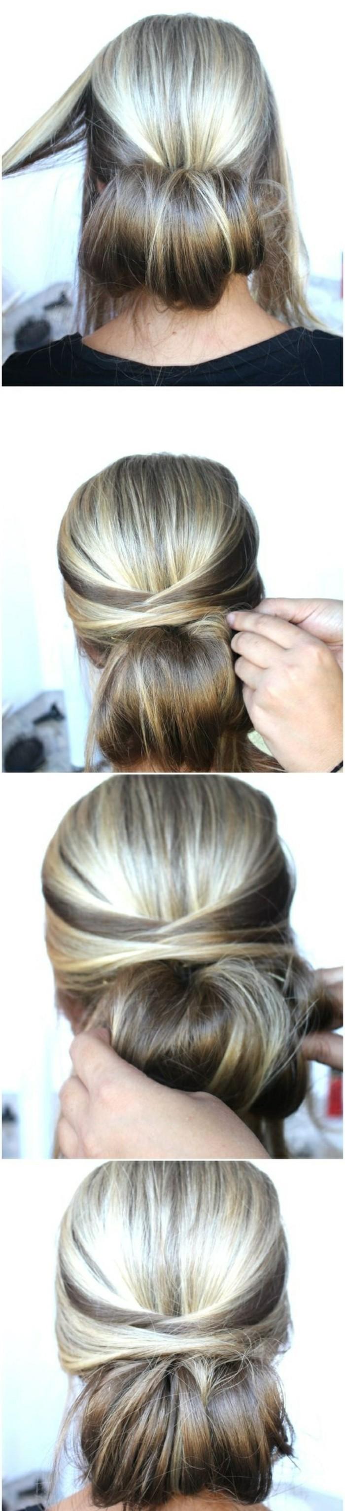 chignon bas avec des mèches latérales croisées en arrière de la tête, idée de coiffure mariée cheveux attachés
