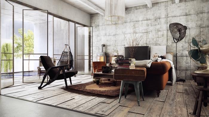 idée deco salon industriel, salon avec plafond blanc et plancher béton aménagée avec meuble style industriel en cuir et bois
