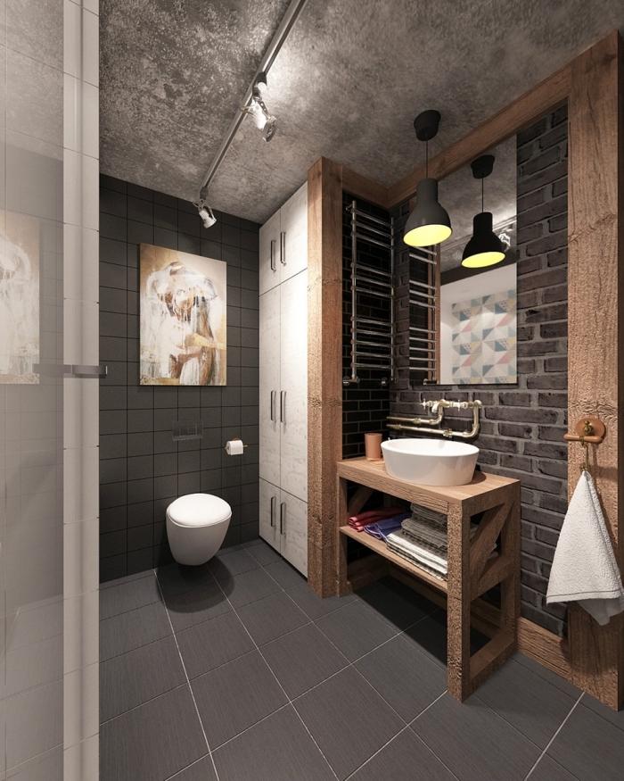 design intérieur contemporain dans une petite salle de bain, deco industrielle avec dalles en gris foncé et plafond effet béton