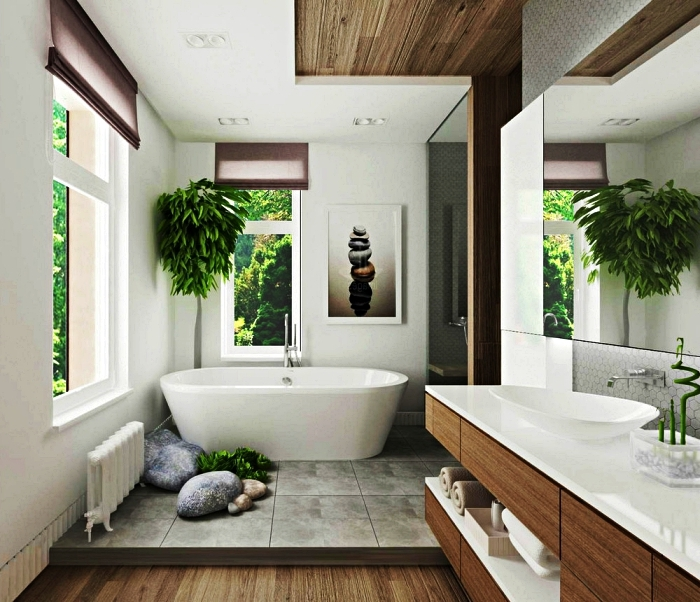 salle de bain zen et chaleureuse en bois et blanc inspirée du style japonais avec une baignoire îlot sur podium, un poster mural zen et une plante bambou