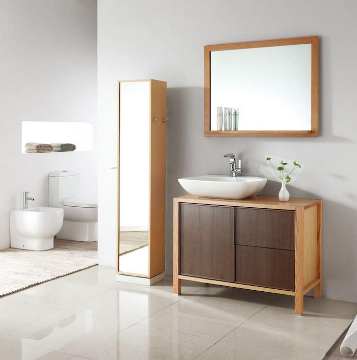 Moderne pièce avec lavabo, meuble rangement, toilettes, tendance salle de bain en bois et blanc moderne au style scandinave