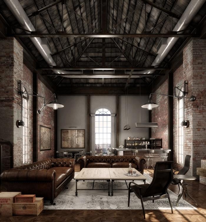 aménagement loft industriel avec plafond poutres apparentes et murs en briques rouges, meuble de salon cuir marron