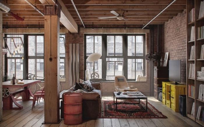 deco industrielle avec colonnes et poutres apparentes, aménagement salle à manger ouverte avec machineries