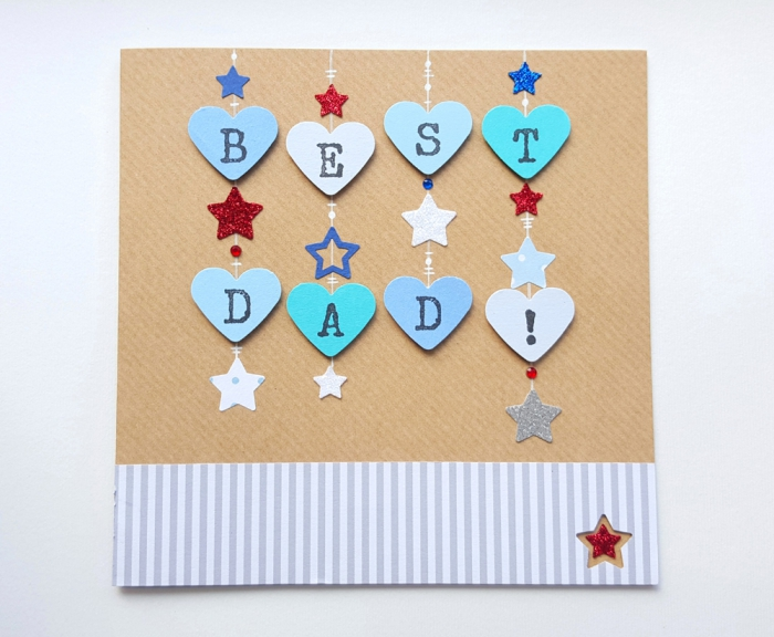carte fete des peres, exemple de carte pour papa fait main en papier cartonné décoré de coeurs bleus, idée perforatrice coeur pour scrapbooking,
